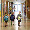 JOED VIERA/STAFF PHOTOGRAPHER-Lockport, NY- Kindergarteners Aden, Austin and Sal Buscaglia, all 5 walk the halls of George M. Southard Elementary School at the end of the first week of school.