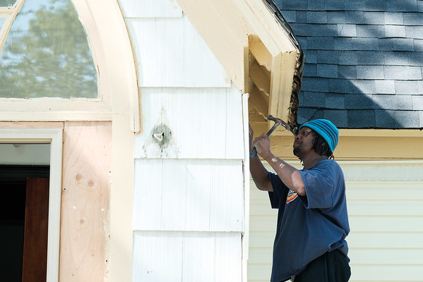 JOED VIERA/STAFF PHOTOGRAPHER-Lockport, NY-Aaron Thagard works on converting the church on Walnut Street into a home.