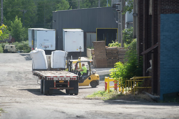 JOED VIERA/STAFF PHOTOGRAPHER-Lockport, NY- A forklift stacks material on a flatbed at HTI.