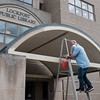 JOED VIERA/STAFF PHOTOGRAPHER-Lockport, NY-Steven Bowler puts a fresh coat of paint on the archway of the Lockport Public Library.