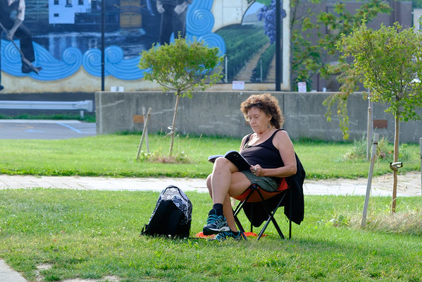 "JOED VIERA/STAFF PHOTOGRAPHER- Lockport, NY-On an unusually warm autumn day Rose Batt reads over her self -published book ""Cut Off"" searching for inspiration in the words for her next project ."