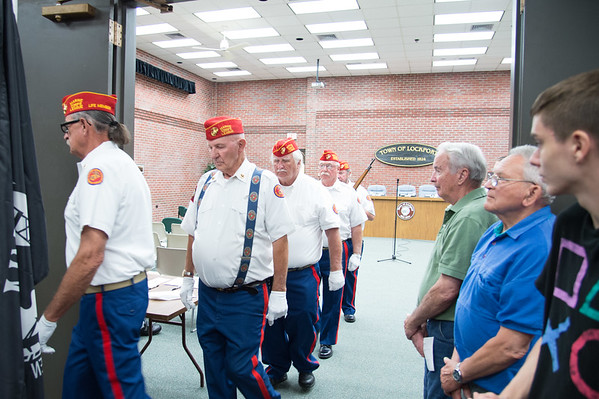 JOED VIERA/STAFF PHOTOGRAPHER- Lockport, NY- The Devil Dog's march to retire the colors at the Veterans Display Case Dedication Ceremony.