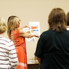JOED VIERA/STAFF PHOTOGRAPHER-Lockport, NY-Marla Guarino explains unit prices to attendees of the Seminar.