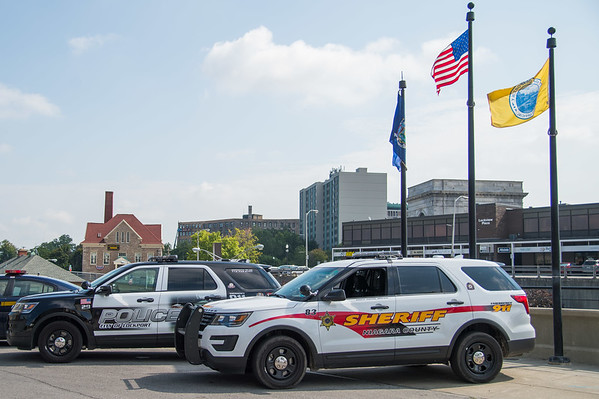 JOED VIERA/STAFF PHOTOGRAPHER-Lockport, NY- Lockport Police and Niagara County Sheriff's vehicles park on Canal Street.