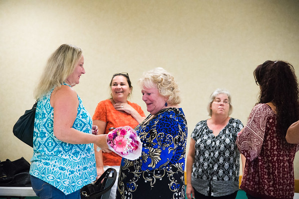 JOED VIERA/STAFF PHOTOGRAPHER-Lockport, NY-  Bonnie Tilyou brings flowers to Shirley Ciliberto before Ciliberto is honored by  the AFSCME union.