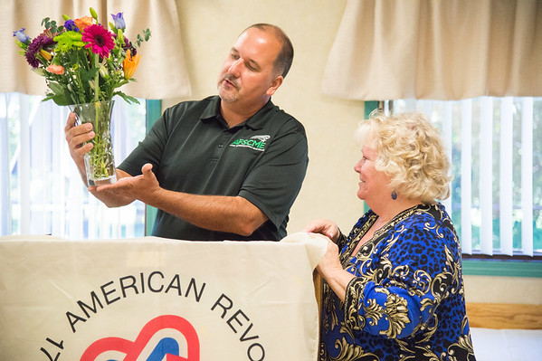 JOED VIERA/STAFF PHOTOGRAPHER-Lockport, NY-  Shirley Ciliberto is honored by Bill Rutland of the AFSCME union.