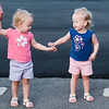 JOED VIERA/STAFF PHOTOGRAPHER-Lockport, NY-  Twins Alexis and Madison Carpenter, 2  prepare to hold hands at Day Road Park.