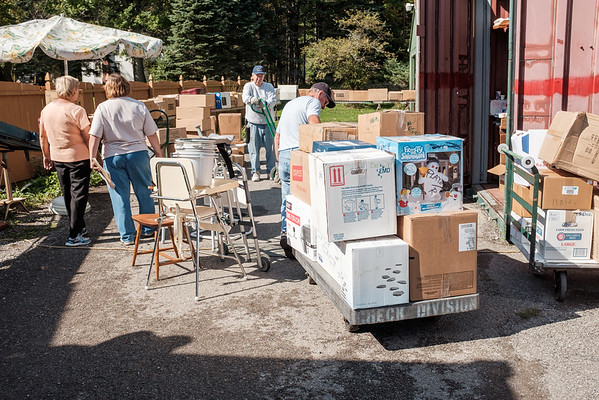 JOED VIERA/STAFF PHOTOGRAPHER-Amherst, NY-Volunteers pack shipping containers with boxes of donations being shipped off to Nicaragua.