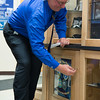 JOED VIERA/STAFF PHOTOGRAPHER- Lockport, NY- Pat Seijak locks up the Time Capsue after the Veterans Display Case Dedication Ceremony.