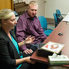 JOED VIERA/STAFF PHOTOGRAPHER- Lockport, NY- Amanda Schmelzle and Kyle Schmelzle discuss Amanda's sister Kari Ann Gorman, who lost her life to domestic violence at the hands of her boyfriend.