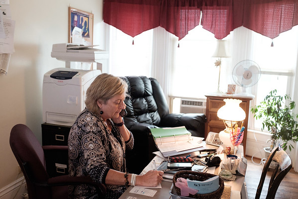 JOED VIERA/STAFF PHOTOGRAPHER-Kathy Jackson speaks to a former resident of the YWCA safe house for domestic violence victims at the houses office.