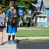 JOED VIERA/STAFF PHOTOGRAPHER-Lockport, NY-  stand outside of their home and bus stop.