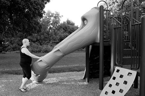 JOED VIERA/STAFF PHOTOGRAPHER-Lockport, NY-   Katie Jo Perry waits for her son Easton at the bottom of a slide at Outwater Park, the day before her surgery.
