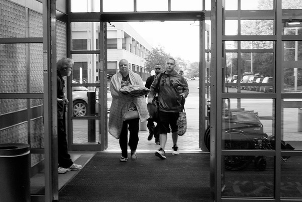 JOED VIERA/STAFF PHOTOGRAPHER-Lockport, NY-   Katie Jo Perry and Kevin Perry walk into Roswell Park Institute the morning of Katie Jo's surgery.