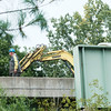 JOED VIERA/STAFF PHOTOGRAPHER- Newfane, NY-Workers fix links on the railroad bridge that runs over Lockport-Olcott Road.