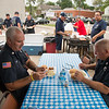 JOED VIERA/STAFF PHOTOGRAPHER-Lockport, NY- Lockport City Firefighters Tom Glenn and Joe Prica enjoy lunch served by American Legion Post 410 volunteers during a cookout outside of the Lockport Police Department.