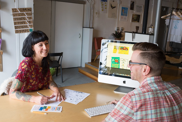 JOED VIERA/STAFF PHOTOGRAPHER-Lockport, NY-Laura and Matt Duquette plan for the Charles Street Shindig at their business, 12 Grain Studio.