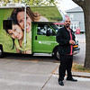 JOED VIERA/STAFF PHOTOGRAPHER-Lockport, NY-Miguel Diaz hands out business cards promoting WellCare's medicare and medicaid plans on Locust Street.
