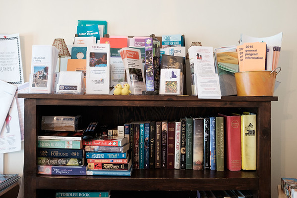 JOED VIERA/STAFF PHOTOGRAPHER-Books and informational pamphlets line a bookshelf at the YWCA safe house for domestic violence victims.