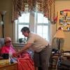 JOED VIERA/STAFF PHOTOGRAPHER-Gasport, NY-  Volunteer Nurse Barbara Jesz tends to a patient at Niagara Hospice.
