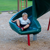 JOED VIERA/STAFF PHOTOGRAPHER-Lockport, NY-  Mason Devoe 5 plays on a slide at Day Road Park.