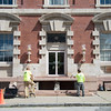 JOED VIERA/STAFF PHOTOGRAPHER-Lockport, NY-A crew works on restoring the steps at the Old Post Office on Elm Street.