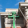 JOED VIERA/STAFF PHOTOGRAPHER- Lockport, NY- Crews work on the gutters of the Old Post Office.