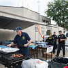 JOED VIERA/STAFF PHOTOGRAPHER-Lockport, NY- American Legion Post 410 volunteers served the Niagara County Sheriff Department along with Lockport Police and City Firefighters lunch during a cookout outside of the Lockport Police Department.