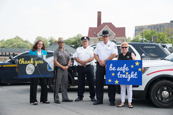 JOED VIERA/STAFF PHOTOGRAPHER- Lockport, NY-Mary Brennan Taylor, State Police Captain Eric Laughton, Lockport Police Chief Mike Neithe, Niagara County Sheriff James Voutour and Ellen Martin  stand on Canal Street.