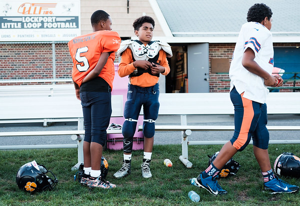 JOED VIERA/STAFF PHOTOGRAPHER-Lockport, NY-Lockport Little Loop Panthers players Trent Hamilton, Taeven Haney and Jayden Wilson get ready for practice.