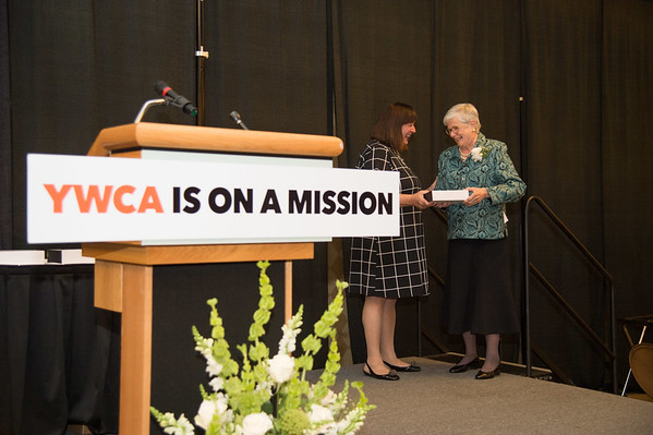 JOED VIERA/STAFF PHOTOGRAPHER--Niagara Falls,NY-Kathy Granchelli presents Christa Caldwell with a lifetime achievement award at the YWCA Niagara Awards.