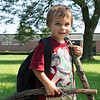 JOED VIERA/STAFF PHOTOGRAPHER-Lockport, NY-Quincy Carpenter, 3, carries sticks on his way from picking his brother up from school Tuesday.