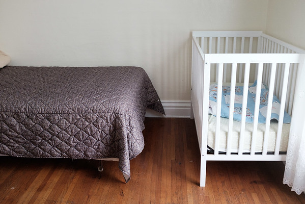 JOED VIERA/STAFF PHOTOGRAPHER-A crib and bed at the YWCA safe house for domestic violence victims.