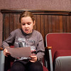 JOED VIERA/STAFF PHOTOGRAPHER-Lockport, NY- Samantha Grzebinski, 7, hoping to play one of tiny Tim's sisters, reads her application while she waits for auditions for Scrooge: The Musical to start at the Historic Palace Theatre. Hopefuls were to bring sheet music and a prepared song for the audition. Auditions were held for second graders and up.