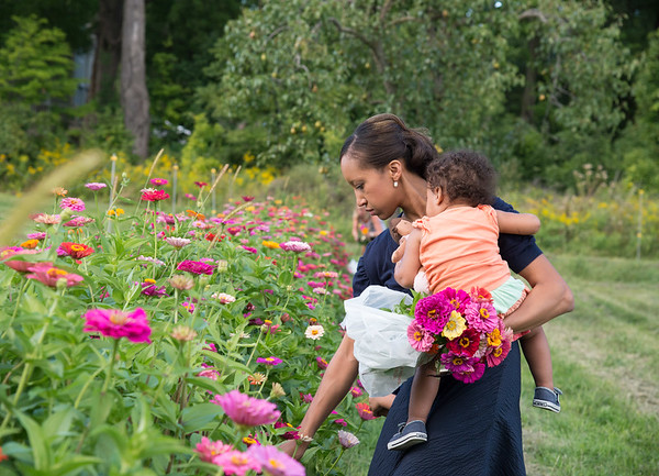 JOED VIERA/STAFF PHOTOGRAPHER-Lockport, NY-  Tammy Roy holds her daughter as she picks flowers at McCollum Orchards.
