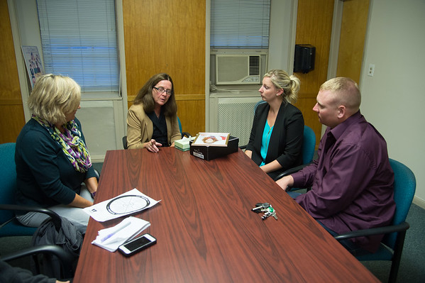 JOED VIERA/STAFF PHOTOGRAPHER- Lockport, NY- Kathy Jackson, Mary Brennan Taylor, Amanda Schmelzle and Kyle Schmelzle discuss Amanda's sister Kari Ann Gorman, who lost her life to domestic violence at the hands of her boyfriend.