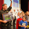 JOED VIERA/STAFF PHOTOGRAPHER-Lockport, NY- Starpoint students watch as Niagara County Sheriffs Deputy Craig Beiter waves while holding up a special thank you photo given to him in celebration of Lockport Blue.