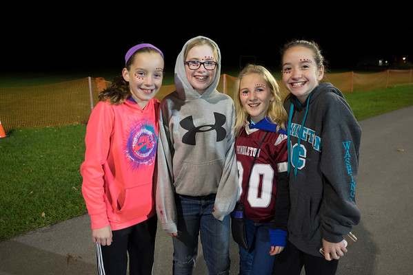 JOED VIERA/STAFF PHOTOGRAPHER-Lockport, NY-Ella Kenyon, Maggie Fidanza, Riley Braunscheidel and Maddykate Murray all 11, stand outside the Starpoint Football game Friday night.