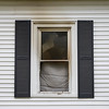 JOED VIERA/STAFF PHOTOGRAPHER-Lockport, NY- Signs of the fire are burned into a window at 605 High Street.