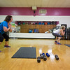 JOED VIERA/STAFF PHOTOGRAPHER-Lockport, NY- Sue Bochenski squats with  Rosalyn Tondera during Core class at the YMCA