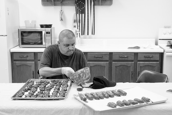 JOED VIERA/STAFF PHOTOGRAPHER-Lockport, NY-Mark Moller pours melted chocolate over peanuts to make peanut clusters at the Dale Association.