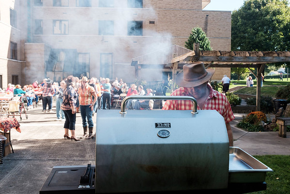 JOED VIERA/STAFF PHOTOGRAPHER-Lockport, NY-Owner David Tosetto cooks up sausages for the hoe down held at Mountview.