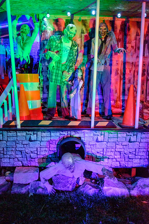 JOED VIERA/STAFF PHOTOGRAPHER-Lockport, NY-Zombies creep on the porch of the halloween display in front of 25 Crosby Avenue.