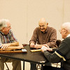 JOED VIERA/STAFF PHOTOGRAPHER-Lockport, NY-Jim Conley laughs as Robert Caldwell and John Falls play a game of cribbage at the Dale Association.