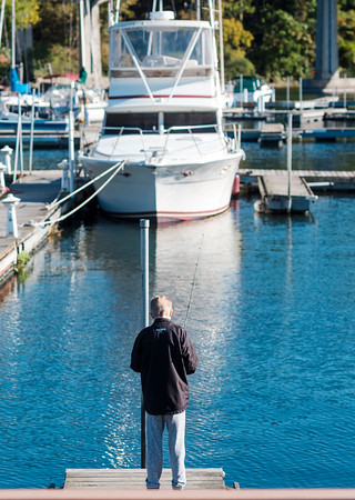 JOED VIERA/STAFF PHOTOGRAPHER-Olcott, NY- Gehrig Wilson ,12, fishes at Newfane Marina.