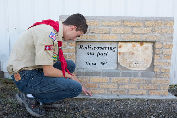 JOED VIERA/STAFF PHOTOGRAPHER-Newfane, NY- Scout Scott Zeitz cleans up a tombstone he installed.