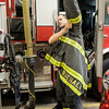 JOED VIERA/STAFF PHOTOGRAPHER-Lockport, NY- Lockport Firefighter Chad Ruchala dresses up at the Fire Department.