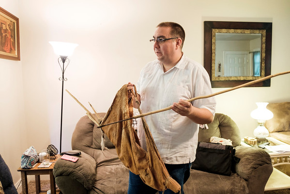 JOED VIERA/STAFF PHOTOGRAPHER-Newfane, NY-Ed Pettitt shows off a hunting sack  given to him during his time in Africa.