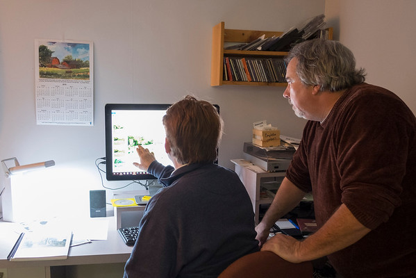 JOED VIERA/STAFF PHOTOGRAPHER-Lockport, NY-Shelley Richards and Jay Krull go over the design of Richards' upcoming book about St. Patricks Cemetary.