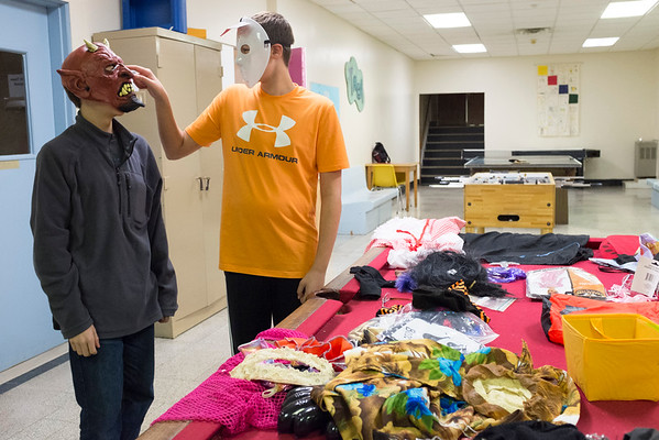 JOED VIERA/STAFF PHOTOGRAPHER-Lockport, NY- Jacob Schnure, 13, and Ryan Santarsiero, 12, try on the free costumes offered by the Ancient Order of Hibernians at the YMCA.
